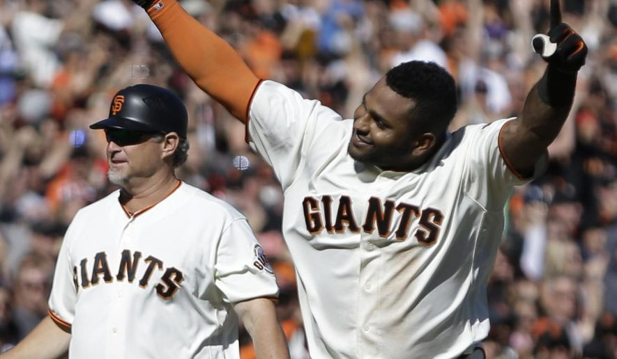 San Francisco Giants' Pablo Sandoval, right, celebrates after hitting a walk off home run against the San Diego Padres in the ninth inning of a baseball game Sunday, Oct. 1, 2017, in San Francisco. (AP Photo/Ben Margot)