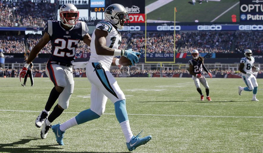 Carolina Panthers wide receiver Devin Funchess, centercatches a touchdown pass in front of New England Patriots cornerback Eric Rowe (25) during the first half of an NFL football game, Sunday, Oct. 1, 2017, in Foxborough, Mass. (AP Photo/Steven Senne)