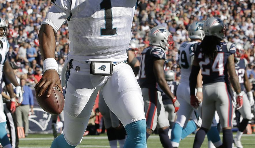 Carolina Panthers quarterback Cam Newton celebrates his rushing touchdown against the New England Patriots during the second half of an NFL football game, Sunday, Oct. 1, 2017, in Foxborough, Mass. (AP Photo/Steven Senne)