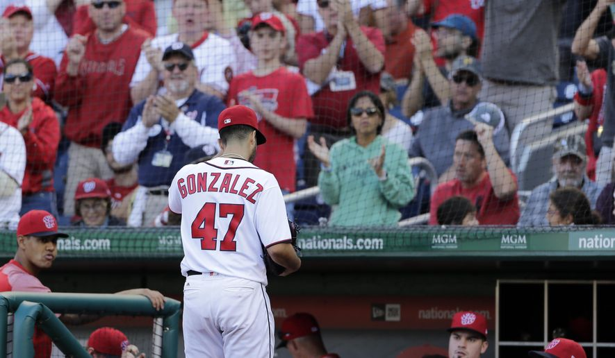 Washington Nationals starting pitcher Gio Gonzalez acknowledges fans after being relieved during the fifth inning of a baseball game against the Pittsburgh Pirates, Sunday, Oct. 1, 2017, in Washington. (AP Photo/Mark Tenally)
