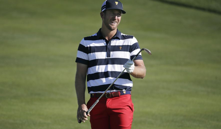U.S. Team member Kevin Chappell reacts to his shot on the 17th hole during the final round of the Presidents Cup golf tournament at Liberty National Golf Club in Jersey City, N.J., Sunday, Oct. 1, 2017. (AP Photo/Julio Cortez)