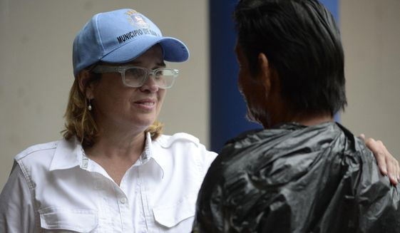 Mayor Carmen Yulin Cruz speaks with a man as she arrives at San Francisco hospital in the Rio Piedras area of San Juan, Puerto Rico, Saturday, Sept. 30, 2017, as about 35 patients are evacuated after the failure of an electrical plant. (AP Photo/Carlos Giusti)