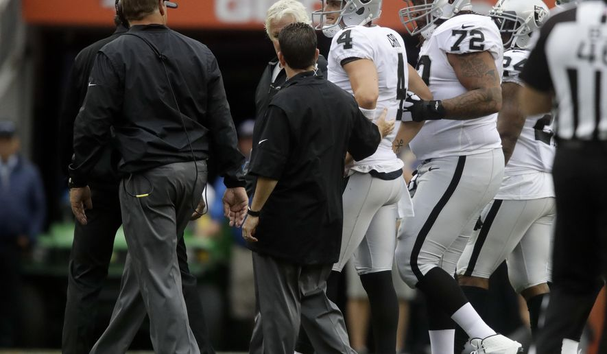 Oakland Raiders quarterback Derek Carr is helped off the field after being injured during the second half of an NFL football game against the Denver Broncos Sunday, Oct. 1, 2017, in Denver. (AP Photo/Jack Dempsey)