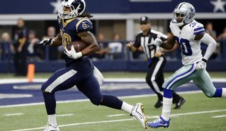 Los Angeles Rams running back Todd Gurley (30) sprints to the end zone past Dallas Cowboys cornerback Anthony Brown, right, for a touchdown in the second half of an NFL football game, Sunday, Oct. 1, 2017, in Arlington, Texas. (AP Photo/Michael Ainsworth)