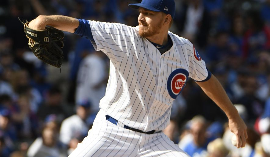 Chicago Cubs starting pitcher Mike Montgomery throws to the Cincinnati Reds during the first inning of a baseball game, Sunday, Oct. 1, 2017, in Chicago. (AP Photo/David Banks)