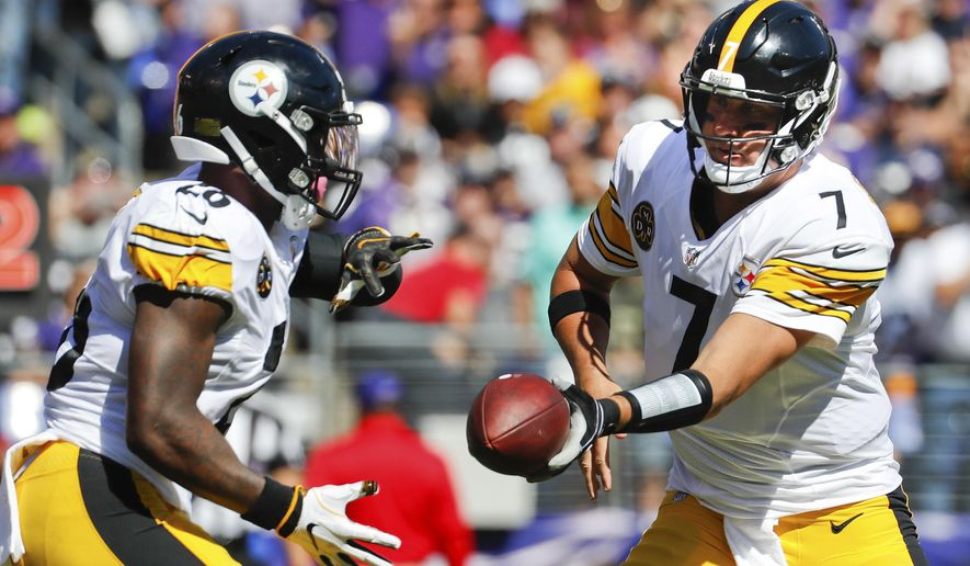Pittsburgh Steelers quarterback Ben Roethlisberger (7) hands off the ball to running back Le'Veon Bell (26) during the first half of an NFL football game against the Baltimore Ravens in Baltimore, Sunday, Oct. 1, 2017. (AP Photo/Alex Brandon)