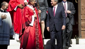 Cardinal Donald Wuerl, Archbishop of Washington, speaks with U.S. Supreme Court Chief Justice John Roberts as they leave St. Mathews Cathedral after the Red Mass in Washington on Sunday, Oct. 1, 2017. The Supreme Court's new term starts Monday, Oct. 2. (AP Photo/Jose Luis Magana)
