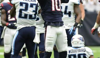Houston Texans wide receiver DeAndre Hopkins (10) celebrates a catch for a first down against the Tennessee Titans during the first half of an NFL football game, Sunday, Oct. 1, 2017, in Houston. (AP Photo/George Bridges)