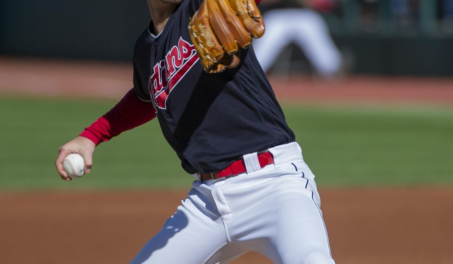 Cleveland Indians starting pitcher Josh Tomlin delivers to Chicago White Sox's Yoan Moncada during the first inning of a baseball game in Cleveland, Sunday, Oct. 1, 2017. (AP Photo/Phil Long)