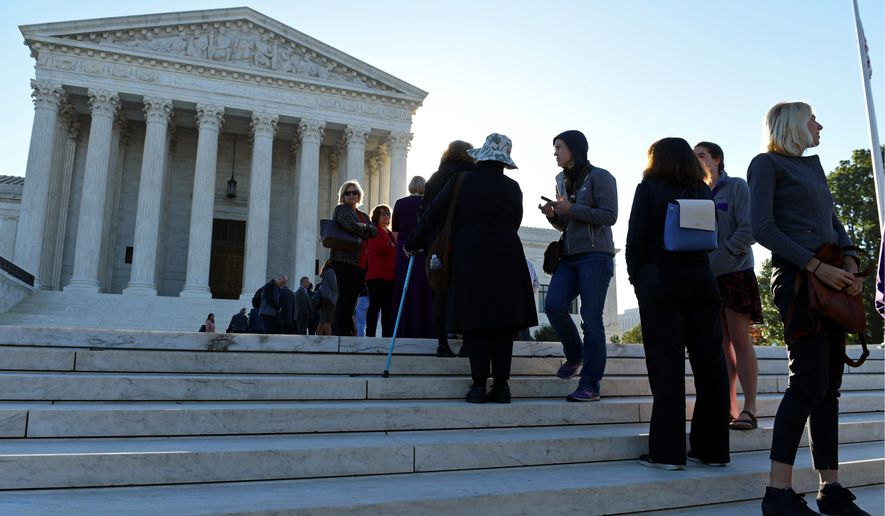 People stand in line to go into the Supreme Court in Washington, Monday, Oct. 2, 2017, for the first day of the new term. The Supreme Court term that, by law, begins on the first Monday in October includes several high-profile cases dealing with controversial social issues or with the potential to affect millions of Americans. (AP Photo/Susan Walsh) (Associated Press)