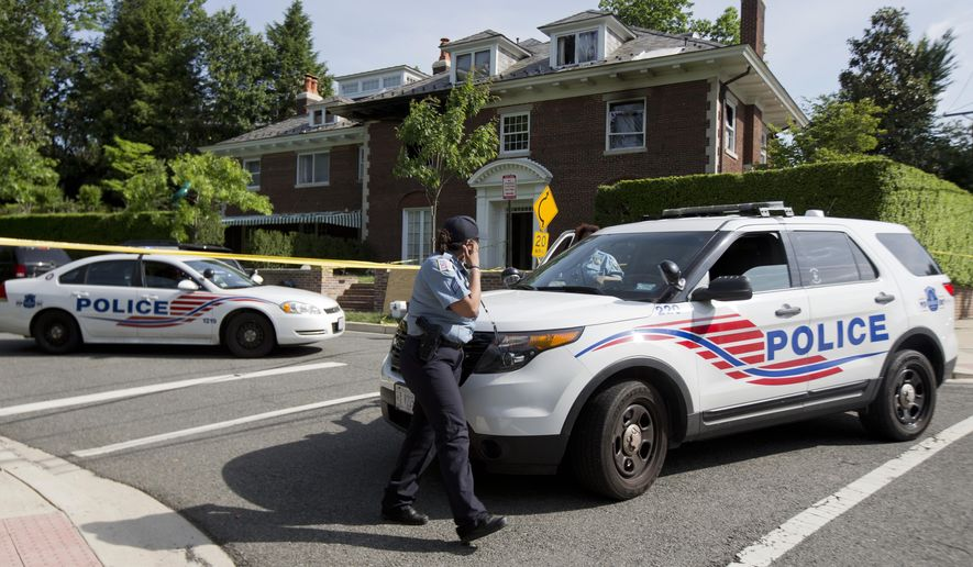 Washington police secure the vicinity around the fire-damaged multimillion-dollar home in northwest Washington, Wednesday, May 20, 2015, where four people were found dead May 14. Washington Police Chief Cathy Lanier earlier identified two of the victims found dead as 46-year-old Savvas Savopoulos and his 47-year-old wife, Amy Savopoulos. Police believe the other two victims are the couple's 10-year-old son and a housekeeper. Police say the deaths are being investigated as a homicide. .   (AP Photo/Manuel Balce Ceneta)