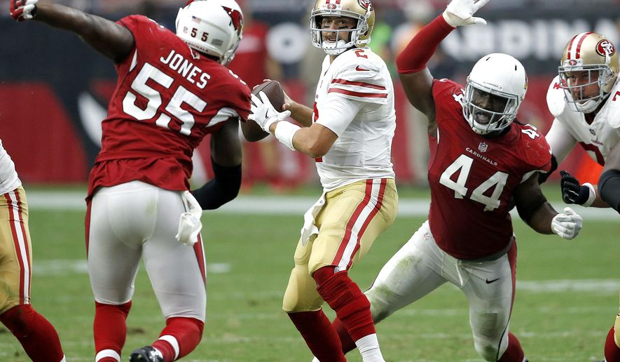 San Francisco 49ers quarterback Brian Hoyer looks to throw as Arizona Cardinals outside linebacker Markus Golden (44) and outside linebacker Chandler Jones (55) pursue during the second half of an NFL football game, Sunday, Oct. 1, 2017, in Glendale, Ariz. (AP Photo/Ross D. Franklin)