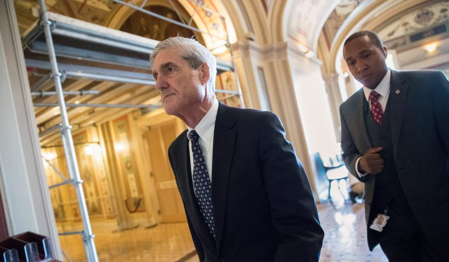 Special counsel Robert Mueller is reported to have his first indictment from a federal grand jury in Washington, and the target could be taken into custody as soon as Monday. (Associated Press/File)