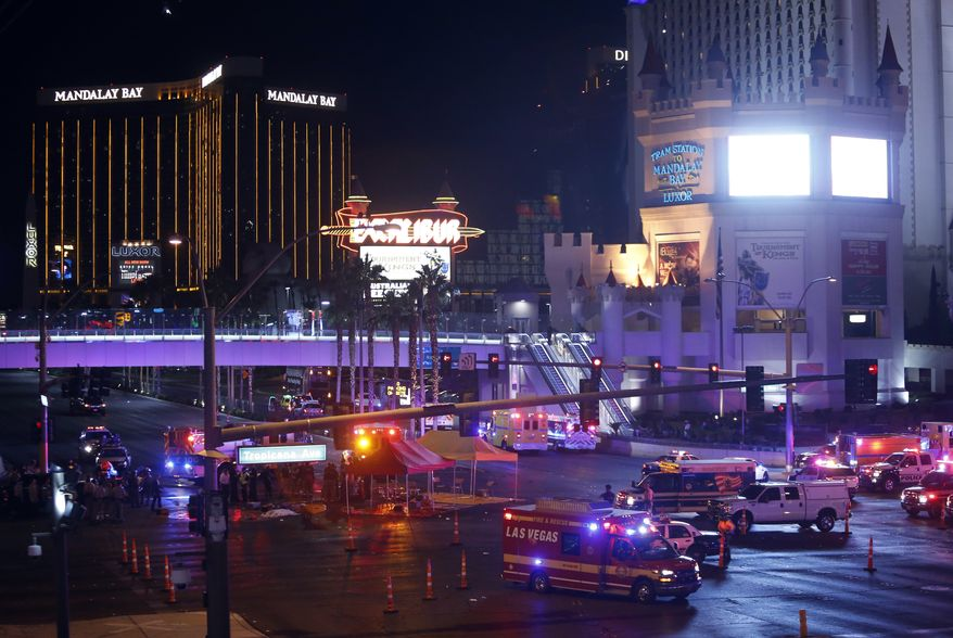 Las Vegas Metro Police and medical workers block off an intersection after a mass shooting at a music festival on the Las Vegas Strip on Sunday, Oct. 1, 2017. (Steve Marcus/Las Vegas Sun via AP)