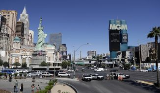 Police block access to part of the strip near the scene of a mass shooting at a music festival, Monday, Oct. 2, 2017, in Las Vegas. (AP Photo/Marcio Jose Sanchez)
