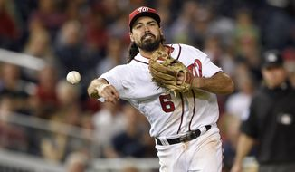 Washington Nationals third baseman Anthony Rendon (6) throws to first during a baseball game against the Pittsburgh Pirates, Thursday, Sept. 28, 2017, in Washington. (AP Photo/Nick Wass)