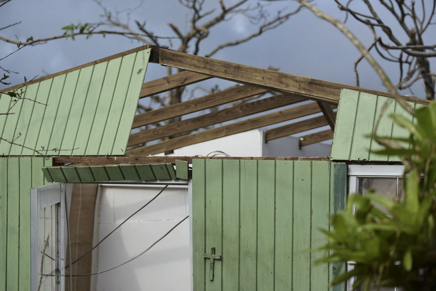 A home stands damaged in the aftermath of Hurricane Maria, in the Montones Cuatro, Sector Piedrazul of Las Piedras in Puerto Rico, Monday, Oct. 2, 2017. Power is still cut off on most of the island, schools and many businesses are closed and much of the countryside is struggling to find fresh water and food. (AP Photo/Carlos Giusti)
