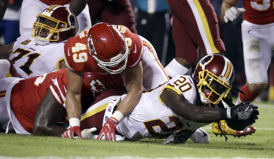 Washington Redskins running back Rob Kelley (20) fails to reach the end zone as Kansas City Chiefs defensive back Daniel Sorensen (49) and a teammate defend during the first half of an NFL football game in Kansas City, Mo., Monday, Oct. 2, 2017. (AP Photo/Charlie Riedel)