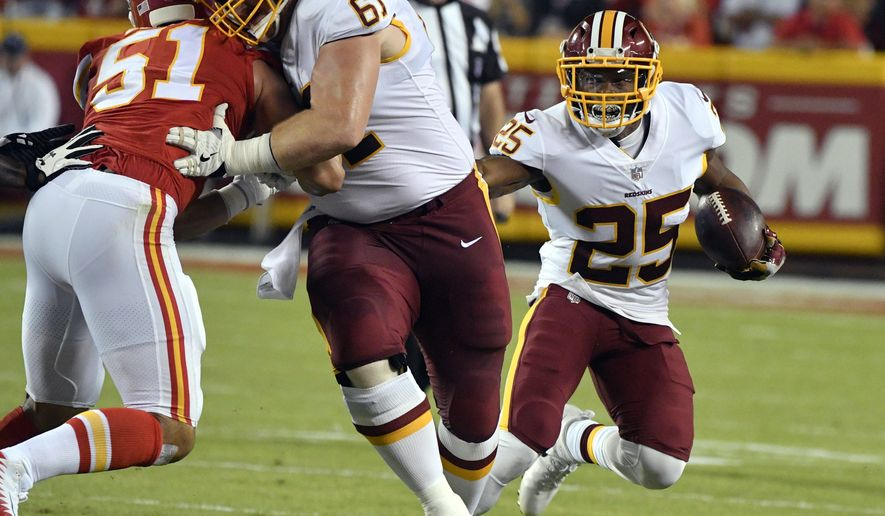 Washington Redskins running back Chris Thompson (25) carries the ball as center Spencer Long (61) blocks Kansas City Chiefs linebacker Frank Zombo (51) during the first half of an NFL football game in Kansas City, Mo., Monday, Oct. 2, 2017. (AP Photo/Ed Zurga)