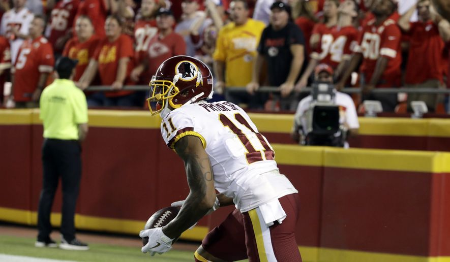 Washington Redskins wide receiver Terrelle Pryor Sr. (11) gets up after catching a touchdown pass during the first half of an NFL football game against the Kansas City Chiefs in Kansas City, Mo., Monday, Oct. 2, 2017. (AP Photo/Charlie Riedel) **FILE**