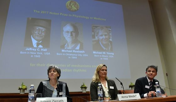 Anna Wedell, chairman of the Nobel committee, center, and members of the committee Juleen Zierath, left, and Carlos Ibanez, announce the winners of the 2017 Nobel Prize for Medicine during a press conference at the Nobel Forum in Stockholm, Monday Oct. 2, 2017. The Nobel Prize for Medicine has been awarded to three Americans for discoveries about the body's daily rhythms. The laureates are Jeffrey c. Hall, Michael Rosbash and Michael W. Young. (Jonas Ekstromer/TT via AP)
