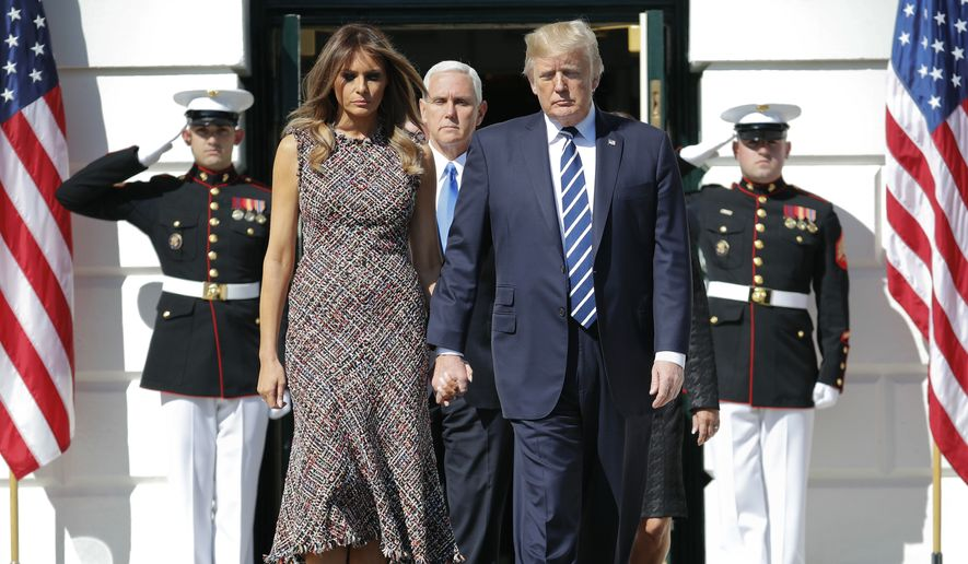 President Donald Trump and first lady Melania Trump followed by Vice President Mike Pence and his wife Karen walk out for a moment of silence to remember the victims of the mass shooting in Las Vegas, on the South Lawn of the White House in Washington, Monday, Oct. 2, 2017. (AP Photo/Pablo Martinez Monsivais)