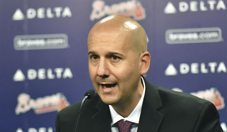 FILe - In this Oct. 1, 2015, file photo, Atlanta Braves general manager John Coppolella speaks during a baseball news conference at Turner Field in Atlanta. Coppolella has resigned from his position, the Braves announced on Monday afternoon, Oct. 2, 2017 (Hyosub Shin/Atlanta Journal-Constitution via AP, File) **FILE**