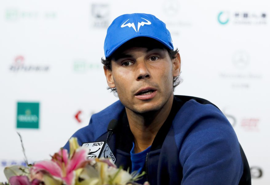 Rafael Nadal of Spain speaks during a news conference of the China Open tennis tournament at the Diamond Court in Beijing, Monday, Oct. 2, 2017. (AP Photo/Andy Wong)