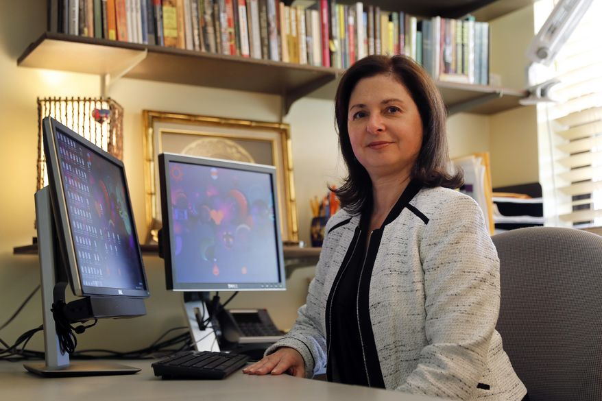 In this Sept. 5, 2017, photo, sociologist Lisa Martino-Taylor poses for a photo in her office in Kirkwood, Mo. Martino-Taylor wrote in a recently released book that the U.S. government secretly exposed hundreds of thousands of people to dangerous radiation, along with chemical and biological materials in Cold War-era testing, including impoverished residents in St. Louis, poor pregnant women in the South and high school students in California. (AP Photo/Jeff Roberson)