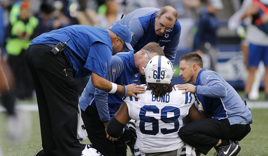 Indianapolis Colts center Deyshawn Bond (69) is tended to after he went down with an injury in the first half of an NFL football game against the Seattle Seahawks, Sunday, Oct. 1, 2017, in Seattle. (AP Photo/Stephen Brashear)