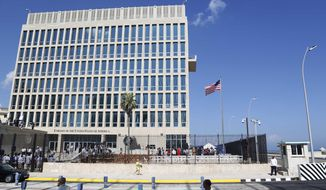 In this Aug. 14, 2015, file photo, a U.S. flag flies at the U.S. embassy in Havana, Cuba. (AP Photo/Desmond Boylan, File)