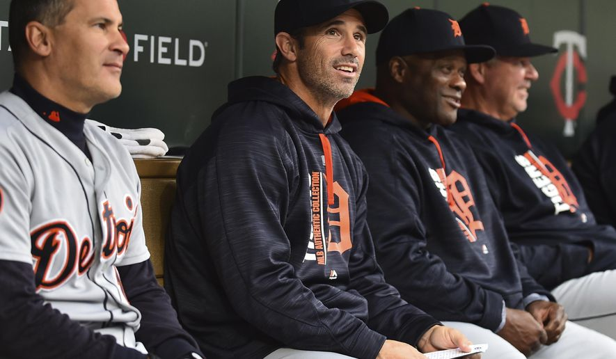 Detroit Tigers manager Brad Ausmus, second from left, sits with his coaches in the dugout as they play the Minnesota Twins in the eighth inning of a baseball game, Sunday, Oct. 1, 2017, in Minneapolis. (AP Photo/John Autey)