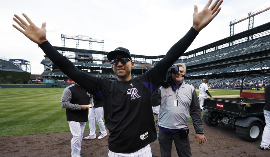 Colorado Rockies right fielder Carlos Gonzalez acknowledges fans during the team's ceremonial walk around the field after a baseball game against the Los Angeles Dodgers Sunday, Oct. 1, 2017, in Denver. The Dodgers won 6-3. (AP Photo/David Zalubowski)