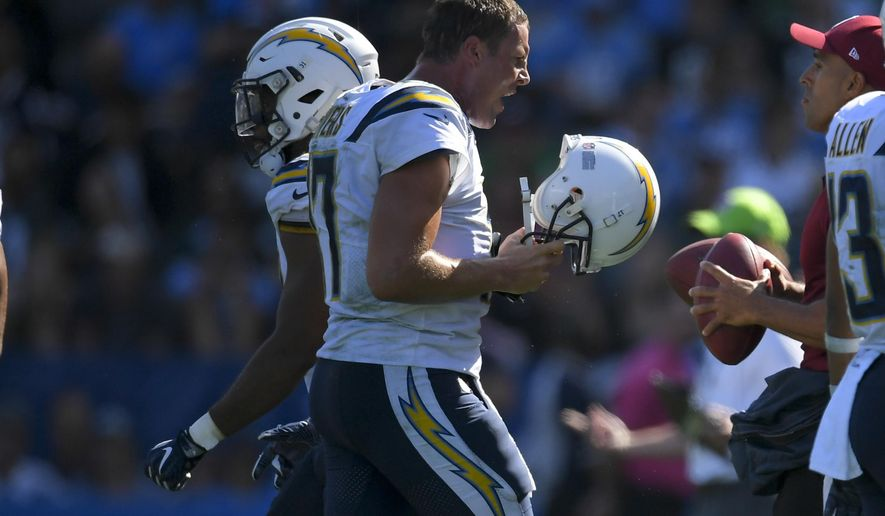 Los Angeles Chargers quarterback Philip Rivers reacts as he comes off the field during the second half of an NFL football game against the Philadelphia Eagles, Sunday, Oct. 1, 2017, in Carson, Calif. (AP Photo/Mark J. Terrill)