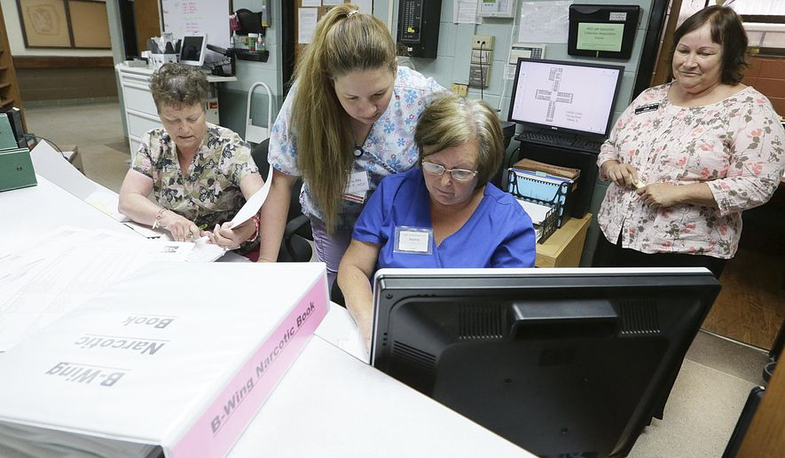 In this Sept. 12, 2017 photo, La Salle County Nursing Home nurses, from left, Cathy  Balzarini, Raylene Rankin, Carrie Becker, and Jane DePaoli, look up patient records as people begIn moving back into the home that was evacuated due to a tornado on Feb. 28, 2017 in Ottawa, Ill. When the tornado hit , the 68 residents were evacuated by midnight, either by going home with family or to one of five other facilities taking in residents. After repairs, former residents continue to return. (Scott Anderson /NewsTribune via AP)