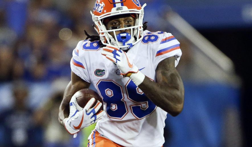 FILE - In this Sept. 23, 2017, file photo, Florida wide receiver Tyrie Cleveland runs the ball during the first half of an NCAA college football game against Kentucky in Lexington, Ky. Florida coach Jim McElwain expects to be without Cleveland against LSU on Saturday, a potentially significant loss for the 21st-ranked Gators. McElwain said Monday, Oct. 2, 2017, that Cleveland is wearing a walking boot on his right foot after badly spraining his ankle against Vanderbilt two days earlier.(AP Photo/David Stephenson, File)