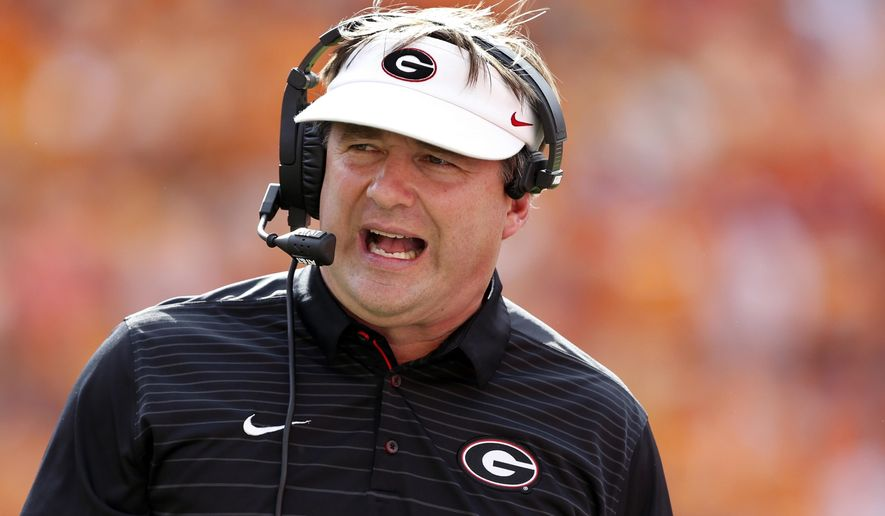 FILE - In this Saturday, Sept. 30, 2017, file photo, Georgia head coach Kirby Smart reacts during the first half of an NCAA college football game against Tennessee, in Knoxville, Tenn. Coach Smart is trying to level excitement as his unbeaten team keeps moving higher in the poll. The No. 5 Bulldogs are back at practice two days after a blowout win at Tennessee, and he wants fans to know that his team is far from perfect. (AP Photo/Wade Payne, File)