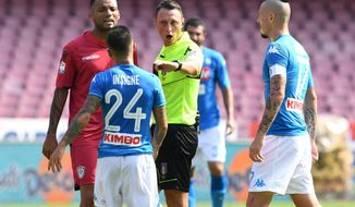 Referee Rosario Abisso talks to Napoli's Lorenzo Insigne as teammate Marek Hamsik, right, looks on during a Serie A match soccer match between Napoli and Cagliari at the San Paolo stadium in Naples, Italy, Sunday, Oct. 1, 2017. (Ciro Fusco/ANSA via AP)