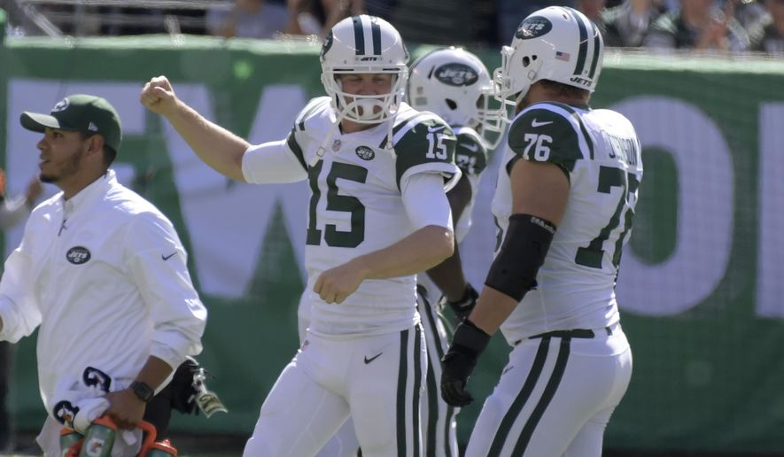 New York Jets quarterback Josh McCown (15), center, reacts after teammate Bilal Powell scored a touchdown during the first half of an NFL football game against the Jacksonville Jaguars, Sunday, Oct. 1, 2017, in East Rutherford, N.J. (AP Photo/Bill Kostroun)