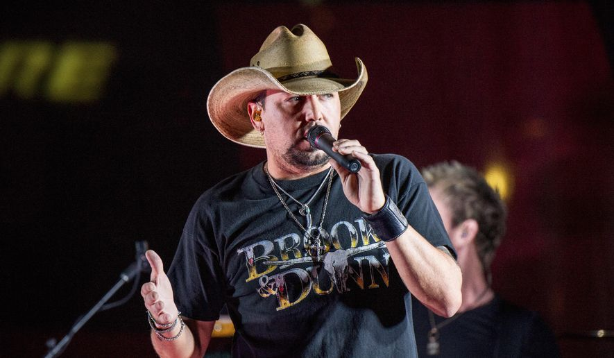 In this June 7, 2017, file photo Jason Aldean performs during a surprise pop-up concert at the Music City Center in Nashville, Tenn. Aldean was the headlining performer when a gunman opened fire at a music festival on the Las Vegas Strip on Sunday, Oct. 1. (Photo by Amy Harris/Invision/AP, File)