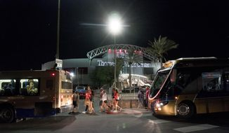 People load into buses destined to different Strip Casinos following a mass shooting at the Route 91 music festival along the Las Vegas Strip, Monday, Oct. 2, 2017. UNLV's Thomas & Mack Center was opened as a place of refuge. (Yasmina Chavez/Las Vegas Sun via AP)