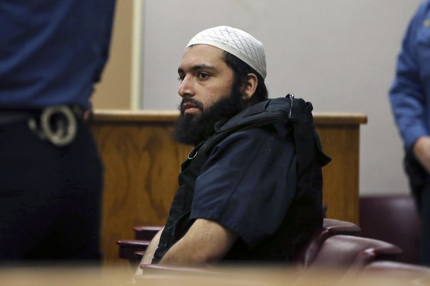 FILE - In this Dec. 20, 2016 file photo, Ahmad Khan Rahimi, the man accused of setting off bombs in New Jersey and New York's Chelsea neighborhood in September, sits in court in Elizabeth, N.J. His trial opens, Monday, Oct. 2, 2017 in New York. (AP Photo/Mel Evans, File)