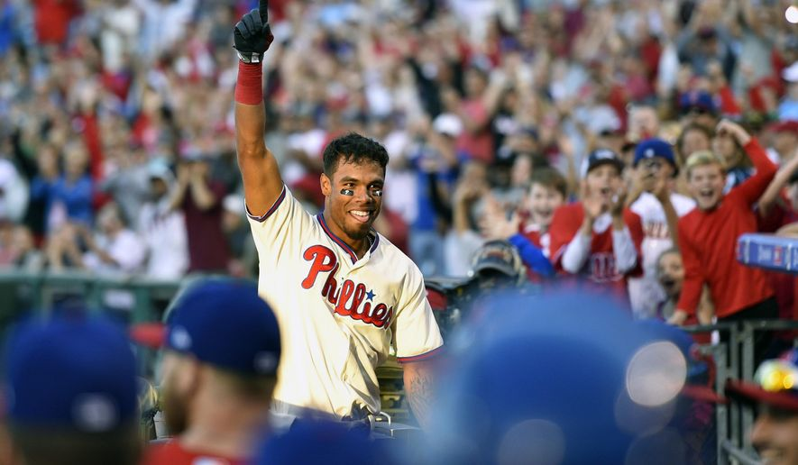 Philadelphia Phillies' Nick Williams waives to the crowd after hitting a three run inside the park home run off New York Mets' Rafael Montero during the eighth inning of a baseball game, Sunday, Oct. 1, 2017, in Philadelphia. The Phillies won 11-0. (AP Photo/Derik Hamilton)