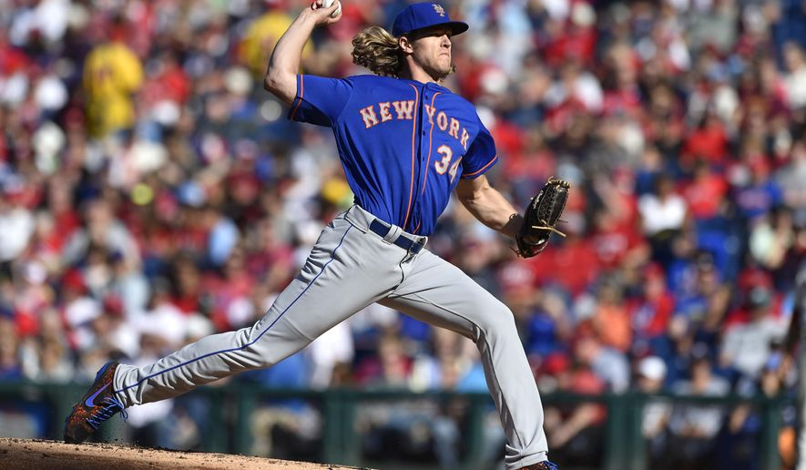 New York Mets starting pitcher Noah Syndergaard throws during the second inning of a baseball game against the Philadelphia Phillies, Sunday, Oct. 1, 2017, in Philadelphia. (AP Photo/Derik Hamilton)