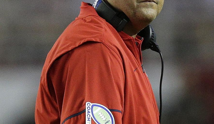 Mississippi head coach Matt Luke looks at the scoreboard during the first half of an NCAA college football game Alabama, Saturday, Sept. 30, 2017, in Tuscaloosa, Ala. (AP Photo/Brynn Anderson)