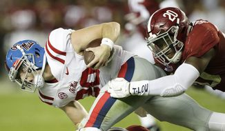 Mississippi quarterback Shea Patterson is tackled by Alabama linebacker Shaun Dion Hamilton during the first half of an NCAA college football game, Saturday, Sept. 30, 2017, in Tuscaloosa, Ala. (AP Photo/Brynn Anderson)