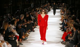 A model wears a creation for the Stella McCartney Spring/Summer 2018 ready-to-wear fashion collection presented in Paris, Monday, Oct. 2, 2017. (AP Photo/Francois Mori)