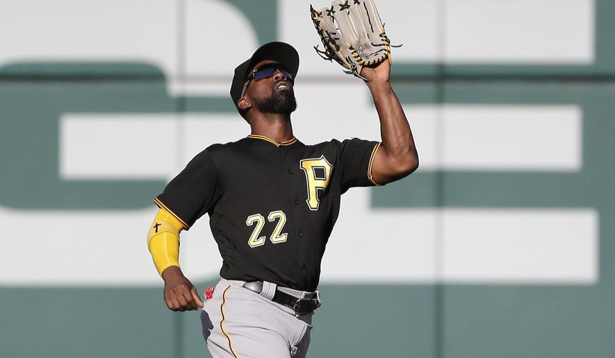 Pittsburgh Pirates center fielder Andrew McCutchen catches a fly ball by Washington Nationals' Anthony Rendon during the fourth inning of a baseball game Sunday, Oct. 1, 2017, in Washington. (AP Photo/Mark Tenally)