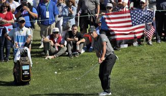 International Team member Hideki Matsuyama hits to the third green during the final round of the Presidents Cup at Liberty National Golf Club in Jersey City, N.J., Sunday, Oct. 1, 2017. (AP Photo/Julio Cortez)