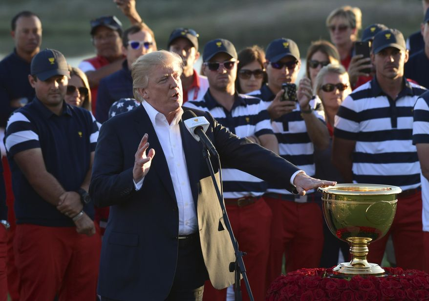 President Donald Trump speaks before presenting the winner's trophy to the U.S. Team after the final round of the Presidents Cup at Liberty National Golf Club in Jersey City, N.J., Sunday, Oct. 1, 2017. (AP Photo/Susan Walsh)
